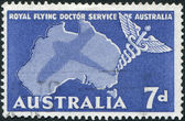 A stamp printed in Australia, is dedicated to Royal Flying Doctor Service of Australia, shows the Caduceus and Map of Australia, circa 1957 — Stock Photo