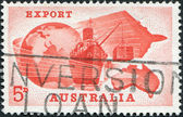 A stamp printed in Australia, is dedicated Importance of exports to Australian economy, is shown Globe, Ship, Plane and Map of Australia — Stock Photo