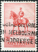 """A stamp printed in Australia, dedicated to 25th anniversary of the coronation, shows George V on His Charger """"Anzac"""", circa 1935 — Stock Photo"""