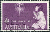 A stamp printed in Australia, shows the Star of Bethlehem and Praying Child, circa 1957 — Stock Photo