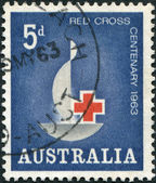 A stamp printed in Australia, is dedicated to the 100th anniversary of the International Red Cross, the emblem of the Red Cross, circa 1963 — Stock Photo