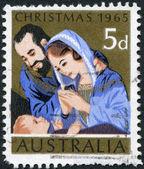 штамп напечатан в австралии, посвященный рождеству, изображает святое семейство, около 1965 — Стоковое фото