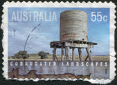 A stamp printed in Australia, shows a water container made of corrugated iron, circa 2009 — Stock Photo