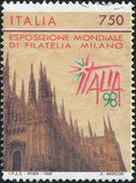 A stamp printed in Italy, is dedicated to the International Philatelic Exhibition, ITALIA - 98, shows the Cathedral of Milan, circa 1996 — 图库照片