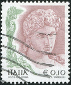 A stamp printed in Italy, shows the Head of terra cotta statue, 3rd century BC, circa 2004 — Stock Photo