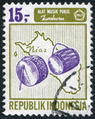 A stamp printed in the Indonesia, shows a musical instrument drum on a map of Nias, circa 1967 — Stock Photo