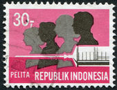 A stamp printed in the Indonesia, is dedicated to Five-year Development Plan. Family and hypodermic syringe, circa 1969 — Stock Photo