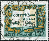 A stamp printed in Italy, is dedicated to the 10th anniversary of the Constitution shows Book and Symbols of Labor Industry and Agriculture — Stock Photo