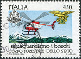 A stamp printed in Italy, is dedicated to Forest Preservation, shows Helicopter fire patrol, circa 1984 — Stock Photo