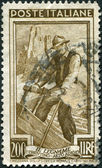 A stamp printed in Italy, shows the Woodcutter, the background Vajolet Towers (South Tyrol), circa 1950 — Stock Photo