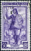 A stamp printed in Italy, shows the Shepherd and flock, watchtower (Sardinia), circa 1950 — Stock Photo