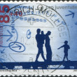 "SWITZERLAND - CIRCA 2009: A stamp printed in Switzerland, shows a young family, a series of ""Pro Juventute"", circa 2009 — Stock Photo"
