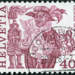 SWITZERLAND - CIRCA 1977: A stamp printed in Switzerland, is depicted Herald reading proclamation and men scaling wall, Geneva, circa 1977 - Stock Photo