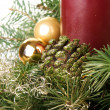 Christmas decorations from fir, cones and candles. - Stock Photo