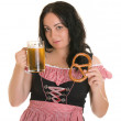 An attractive woman in Bavarian national dress (Dilndl), with a beer and bagels. Oktoberfest. Isolated. — Foto de Stock