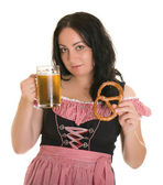 An attractive woman in Bavarian national dress (Dilndl), with a beer and bagels. Oktoberfest. Isolated. — Stock Photo