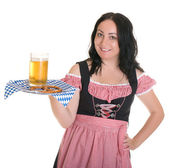 The waitress from Bavaria in the traditional dress has a beer and bretsel. — Stock Photo
