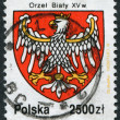 Royalty-Free Stock Photo: POLAND - CIRCA 1992: A stamp printed in the Poland, the State Emblem of Poland in 1990, circa 1992