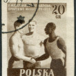 Royalty-Free Stock Photo: POLAND - CIRCA 1955: A stamp printed in the Poland, dedicated to the 2nd International Youth Games (race three African, European and Asian), circa 1955