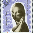 "ROMANIA - CIRCA 1967: A stamp printed in the Romania, dedicated to the 10th anniversary of the death of Constantin Brancusi, shows the composition of ""Mademoiselle P - Stock Photo"