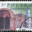 Royalty-Free Stock Photo: POLAND - CIRCA 2003: A stamp printed in the Poland, shows Town Hall, church archway Sandomierz, circa 2003