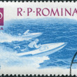 Stock Photo: ROMANI- CIRC1962: stamp printed in Romania, dedicated to water sports, shows race for motorboat (speedboat), circ1962
