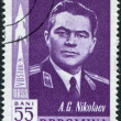 ROMANIA - CIRCA 1962: A stamp printed in the Romania, shows Soviet cosmonaut Andriyan Nikolayev and the silhouette of space rocket Vostok 3, circa 1962 — Stock Photo