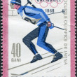 ROMANIA - CIRCA 1967: A stamp printed in the Romania, dedicated to the Winter Olympics in Grenoble, is shown biathlete, circa 1967 - Stock Photo
