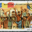 ROMANIA - CIRCA 1990: A stamp printed in the Romania, dedicated to the first anniversary of the fall of the dictatorship of Ceausescu, shows the Opera Square (Victor — Stock Photo