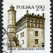 POLAND - CIRCA 1980: A stamp printed in the Poland, dedicated to the 1000th anniversary of Sandomierz, shows the Town Hall, circa 1980 - Stock Photo