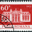 ROMANIA - CIRCA 1973: A stamp printed in the Romania, shows the Iasi National Theatre, circa 1973 - Stock Photo