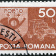 Постер, плакат: ROMANIA CIRCA 1974: A stamp printed in the Romania depicts the postal horn and postal car circa 1974