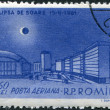 Royalty-Free Stock Photo: ROMANIA - CIRCA 1961: A stamp printed in the Romania, shows the Republic Square in Bucharest and the solar eclipse, circa 1961
