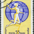 ROMANIA - CIRCA 1962: A stamp printed in the Romania, dedicated to the 2nd Women's Handball Championships, shows Handball Player on a globe, circa 1962 — Stock Photo #12362871