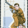 ROMANIA - CIRCA 1965: A stamp printed in the Romania, dedicated to the European Championship by shooting in Bucharest, shows the Small-bore Rifle Shooting, Kneeling, — Stock Photo