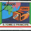 S. TOME E PRINCIPE - CIRCA 1991: A stamp printed in the S. Tome e Principe, shows part of the globe and cargo EMS, circa 1991 - Stock Photo