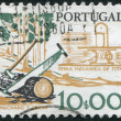 Stock Photo: PORTUGAL - CIRC1979: stamp printed in Portugal, is depicted tool woodcutter, two-handled saw and ax, circ1979