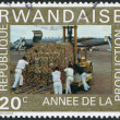 RWANDA - CIRCA 1975: A stamp printed in the Rwanda, shows the loading plane, circa 1975 — Stock Photo