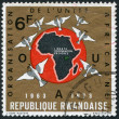 Stock Photo: RWANDA - CIRCA 1973: A stamp printed in the Rwanda, is devoted to 10th anniversary of the Organization of African Unity, circa 1973