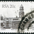 SOUTH AFRICA - CIRCA 1985: A stamp printed in South Africa (RSA), shows a post office in Durban, circa 1985 - Lizenzfreies Foto