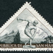 Stock Photo: SAN MARINO - CIRC1953: stamp printed in SMarino, sculpture depicts discus thrower, circ1953