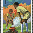 GUINEA - CIRCA 1974: Postage stamps printed in the Republic of Guinea, shows the boy scouts for cooking, circa 1974 — Stock Photo