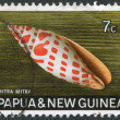 PAPUA NEW GUINEA - CIRCA 1969: Postage stamps printed in Papua New Guinea, is depicted shell Mitra mitra (Episcopal miter), circa 1969 — Stock Photo #12363435