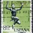SPAIN - CIRCA 1964: A stamp printed in Spain, is dedicated to the Olympic Games in Tokyo, long jump, circa 1964 - Stock Photo
