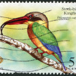 SINGAPORE - CIRCA 2007: Postage stamps printed in Singapore, the bird depicted the Stork-billed Kingfisher (Pelargopsis capensis), circa 2007 - Stock Photo