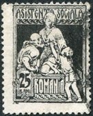 ROMANIA - CIRCA 1921: A stamp printed in the Romania, shows the Charity, circa 1921 — Stock Photo