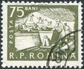 ROMANIA - CIRCA 1960: A stamp printed in the Romania, shows the Cattle feeding, circa 1960 — Stock Photo