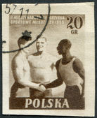 POLAND - CIRCA 1955: A stamp printed in the Poland, dedicated to the 2nd International Youth Games (race three African, European and Asian), circa 1955 — Stock Photo