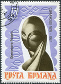 "ROMANIA - CIRCA 1967: A stamp printed in the Romania, dedicated to the 10th anniversary of the death of Constantin Brancusi, shows the composition of ""Mademoiselle P — Stock Photo"