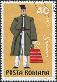 ROMANIA - CIRCA 1973: A stamp printed in the Romania, shows the traditional dress of men in the region Suceava, circa 1973 — Stock Photo